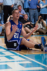 CHAPEL HILL, NC - MARCH 05: Miles Plumlee #21 of the Duke Blue Devils reacts to being call for a foul while playing the North Carolina Tar Heels on March 05, 2011 at the Dean E. Smith Center in Chapel Hill, North Carolina. North Carolina won 67-81. (Photo by Peyton Williams/UNC/Getty Images) *** Local Caption *** Miles Plumlee