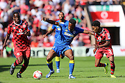 AFC Wimbledon striker Dominic Poleon (10) evades Walsall FC defender Rico Henry (3) and Walsall FC striker Amadou Bakayoko (20) during the EFL Sky Bet League 1 match between Walsall and AFC Wimbledon at the Banks's Stadium, Walsall, England on 6 August 2016. Photo by Stuart Butcher.