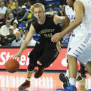 College of Charleston Guard Canyon Barry (24) drives to the paint as Delaware Guard Davon Usher (0) defends in the second half of a NCAA regular season Colonial Athletic Association conference game between Delaware and The College of Charleston Wednesday, Feb 5, 2014 at The Bob Carpenter Sports Convocation Center in Newark Delaware.