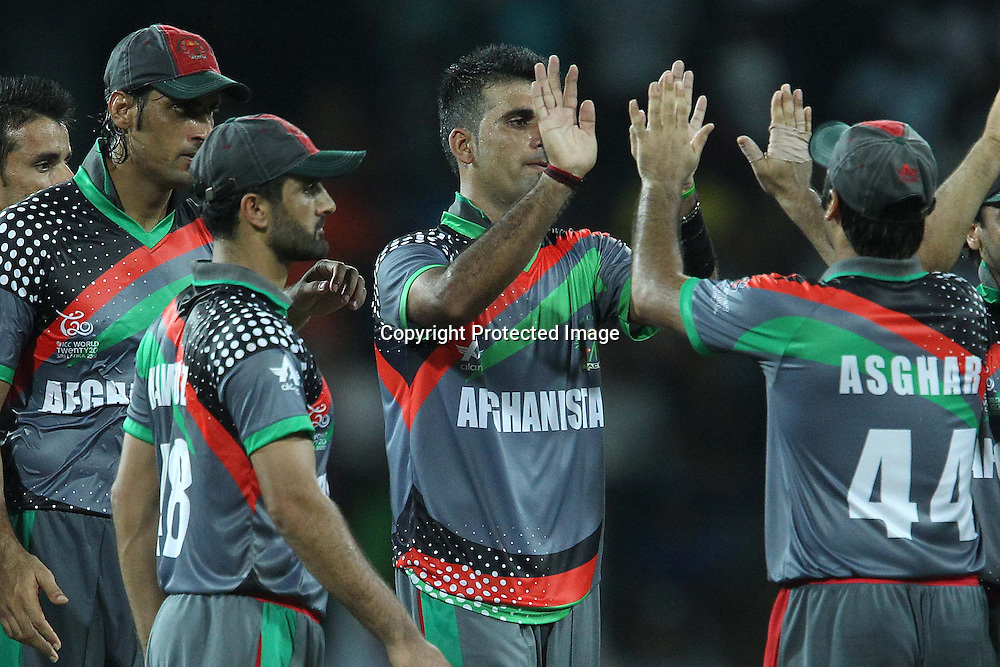 Dalwat Zadran celebrates the wicket of Virat Kholi during the ICC World Twenty20 match between India and Afghanistan held at the Premadasa Stadium in Colombo, Sri Lanka on the 19th September 2012<br /> <br /> Photo by Ron Gaunt/SPORTZPICS