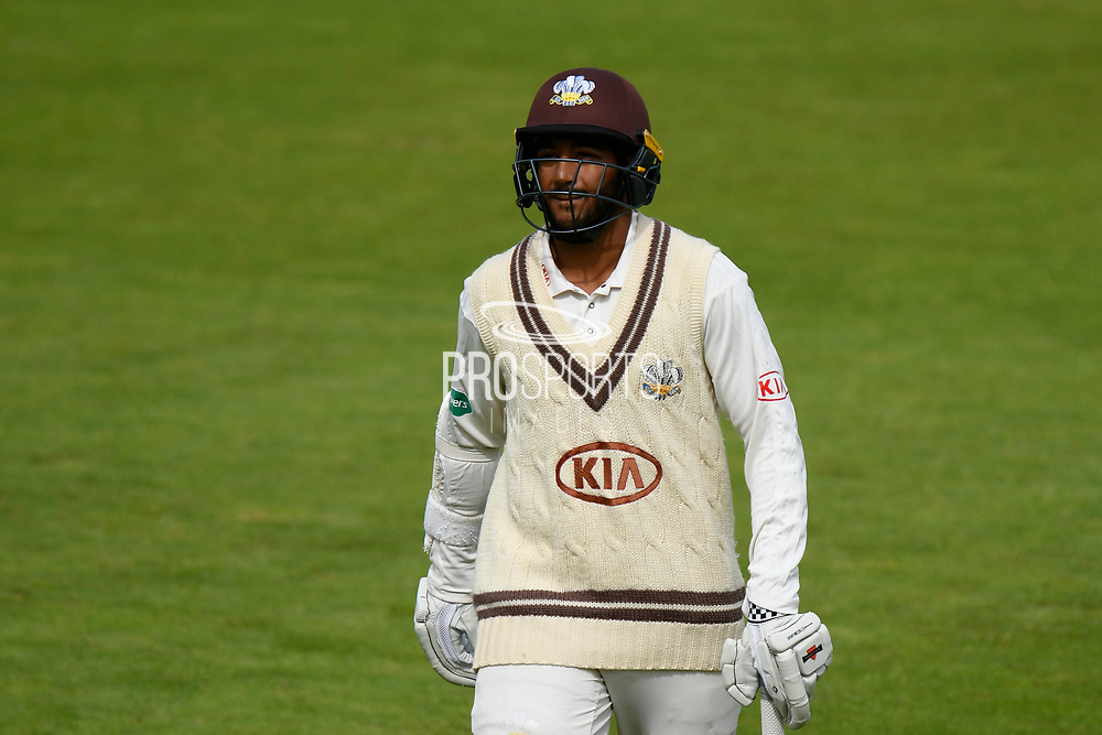 Wicket - Ryan Patel of Surrey walks back to the pavilion after being dismissed by Fidel Edwards of Hampshire during the Specsavers County Champ Div 1 match between Hampshire County Cricket Club and Surrey County Cricket Club at the Ageas Bowl, Southampton, United Kingdom on 6 September 2017. Photo by Graham Hunt.
