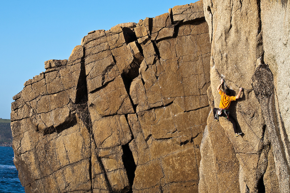 Keita Kanahara climbing 'Let The River Live' E6 6b at Sennen, Cornwall