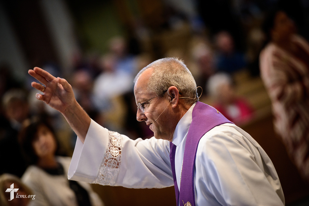 The Rev. Wally Arp, senior pastor of St. Luke's Lutheran Church, gives the sign of the cross during communion at the church on Sunday, March 6, 2016, in Oviedo, Fla. LCMS Communications/Erik M. Lunsford