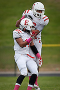 Tua Laupata, left, celebrates with John Fakahafua after an East High School touchdown during the East High School vs. Mountain View High School football game at Mountain View High School in Orem, Tuesday, Oct. 23, 2012.