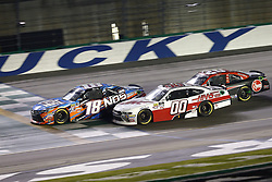 July 13, 2018 - Sparta, Kentucky, United States of America - Kyle Busch (18) Cole Custer (00) and Christopher Bell (20)battle for position during the Alsco 300 at Kentucky Speedway in Sparta, Kentucky. (Credit Image: © Chris Owens Asp Inc/ASP via ZUMA Wire)