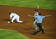 Jul. 15 2011; Phoenix, AZ, USA; Arizona Diamondbacks base runner Willie Bloomquist (18) is called safe after stealing second base during the first inning against the Los Angeles Dodgers  infielder Rafael Furcal (15) at Chase Field. Mandatory Credit: Jennifer Stewart-US PRESSWIRE