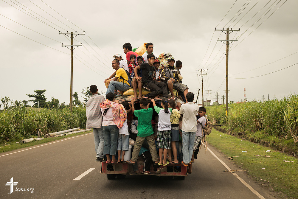 Passengers hitch a ride outside Ormuc, Leyte Province, Philippines, on Sunday, March 16, 2014. LCMS Communications/Erik M. Lunsford
