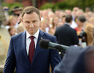 Poland President Andrzej Duda steps to the microphone to make remarks after laying wreaths and flowers at the memorial Tomb of Fallen Soldiers killed by Communists from 1944-63 Sunday, September 18, 2016 in New Britain, Pennsylvania.  (Photo by William Thomas Cain)