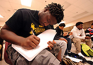 Minneapolis , MN -  April 27, 2015 - Marcellus Ellis takes notes during the Black Male Student Achievement meeting South High School on Monday, April 27, 2015. Photo by Johnny Crawford/ Johnny Crawford Photography