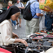 Dominican nun shopping in the outdoor Market at Piazza del Popolo, Orvieto, Italy<br />