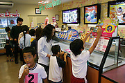 Baskin-Robbins ice cream shop in Okinawa, Japan. Although the island is being studied for clues to Okinawan's great longevity, studies say that the younger population will not live as long because of their diets higher in saturated fats and calories. (Supporting image from the project Hungry Planet: What the World Eats).