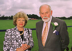 MR & MRS RICHARD DUNHILL of Alfred Dunhill luxery goods, at a polo match in Berkshire on 14th June 1998.MII 3