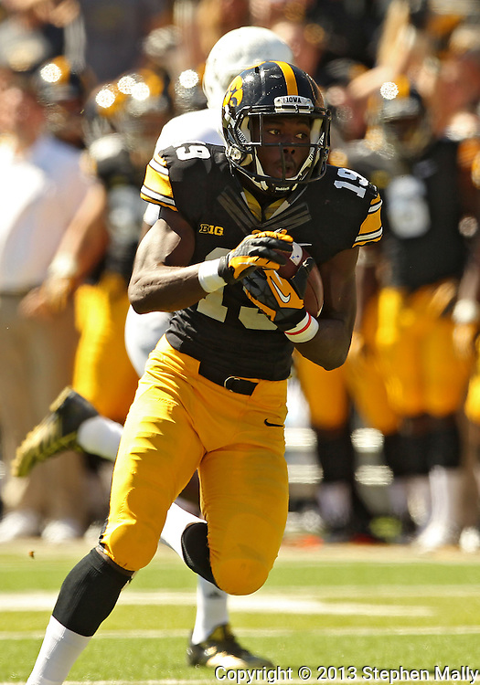 September 21 2013: Iowa Hawkeyes defensive back B.J. Lowery (19) returns an interception 35 yards for a touchdown during the second quarter of the NCAA football game between the Western Michigan Broncos and the Iowa Hawkeyes at Kinnick Stadium in Iowa City, Iowa on September 21, 2013. Iowa defeated Western Michigan 59-3.