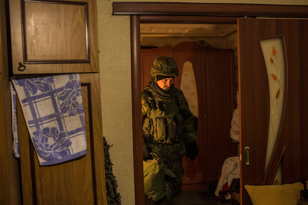PIKSY, UKRAINE - NOVEMBER 19, 2014: A member of the Dnipro-1 brigade, a pro-Ukraine militia, inside the house where he lives with other brigade members in Pisky, Ukraine. The village of Pisky is the scene of much of the front-line fighting over the Donetsk airport. CREDIT: Brendan Hoffman for The New York Times