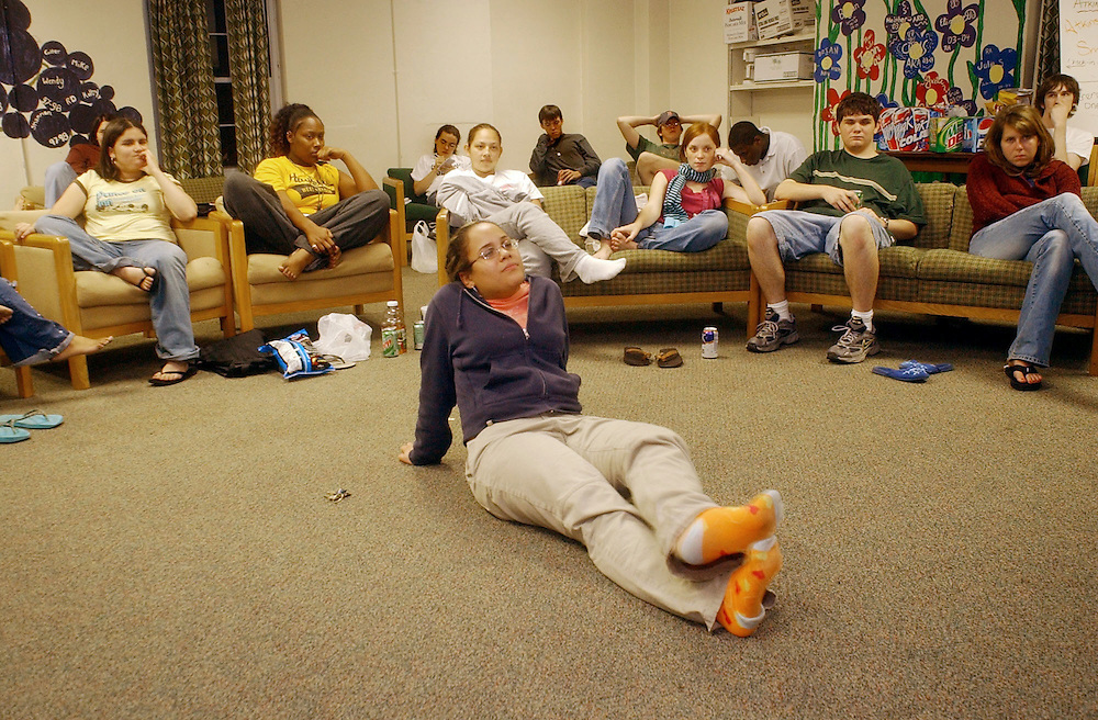 16646Students watching and discussing Presidential Debate: Photos by Colby Ware..9/30/04--(Front seated from left) Ashley Diaz, Ashley Hudson, Tatiana Cruz, Jenny Evans, James Satchell, Lindsay Collins, and Marleny Tapia (foreground) gather to watch the Presidential Debate in Atkinson House.