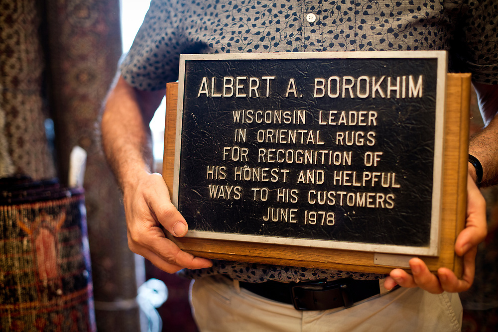 Albert Borokhim displays a plaque he received for his store in 1978, Monday, April 24, 2017.