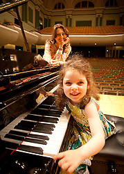 Repro Free: 28/08/2012.Corina Grant with her daughter Caraleigh (aged 4) try out the Steinway Grand Piano at The National Concert Hall in advance of MiniMusic starting in September. MiniMusic is an action-packed music workshop experience for babies and young children aged 3 months to 5 years old, which runs for 10 weeks at The National Concert Hall. More information on nch.ie?. Pic Jason Clarke Photography.