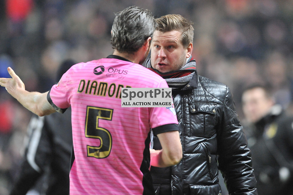 NORTHAMPTON PLAYERS ARGUE THE DISSALLOWED GOAL WITH KARL ROBINSON MK MANAGER  MK Dons v Northampton Town, FA Cup Emirates FA Cup Third round Repay, Stadium MK, Tuesday 19th January 2016