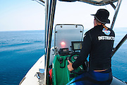 A RIB (Rigid hulled) inflatable boat instructor at the wheel