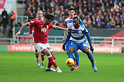 Queens Park Rangers midfielder Junior Hoilett and Bristol City midfielder Marlon Pack battle it out during the Sky Bet Championship match between Bristol City and Queens Park Rangers at Ashton Gate, Bristol, England on 19 December 2015. Photo by Jemma Phillips.