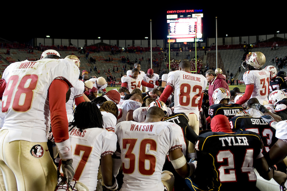 College Park, Maryland - Florida State University football players pray after the game with their opponents from the University of Maryland after defeating them the same day that their teammate, Myron Rolle, won a Rhodes Scholarship..Photo by Susana Raab