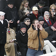 A protestor is escorted out by police during the Inauguration Jan. 20, 2005, at the US Capitol in Washington, DC.  ..Photo by Khue Bui..