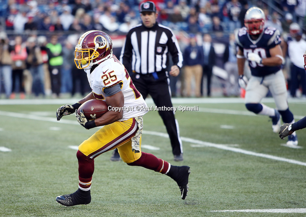 Washington Redskins running back Chris Thompson (25) catches a pass for a gain of 13 yards and a first down at the New England Patriots 6 yard line on a fourth quarter scoring drive during the 2015 week 9 regular season NFL football game against the New England Patriots on Sunday, Nov. 8, 2015 in Foxborough, Mass. The Patriots won the game 27-10. (©Paul Anthony Spinelli)