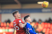 Dan Scare and Ian Henderson during the EFL Sky Bet League 1 match between Walsall and Rochdale at the Banks's Stadium, Walsall, England on 2 February 2019.