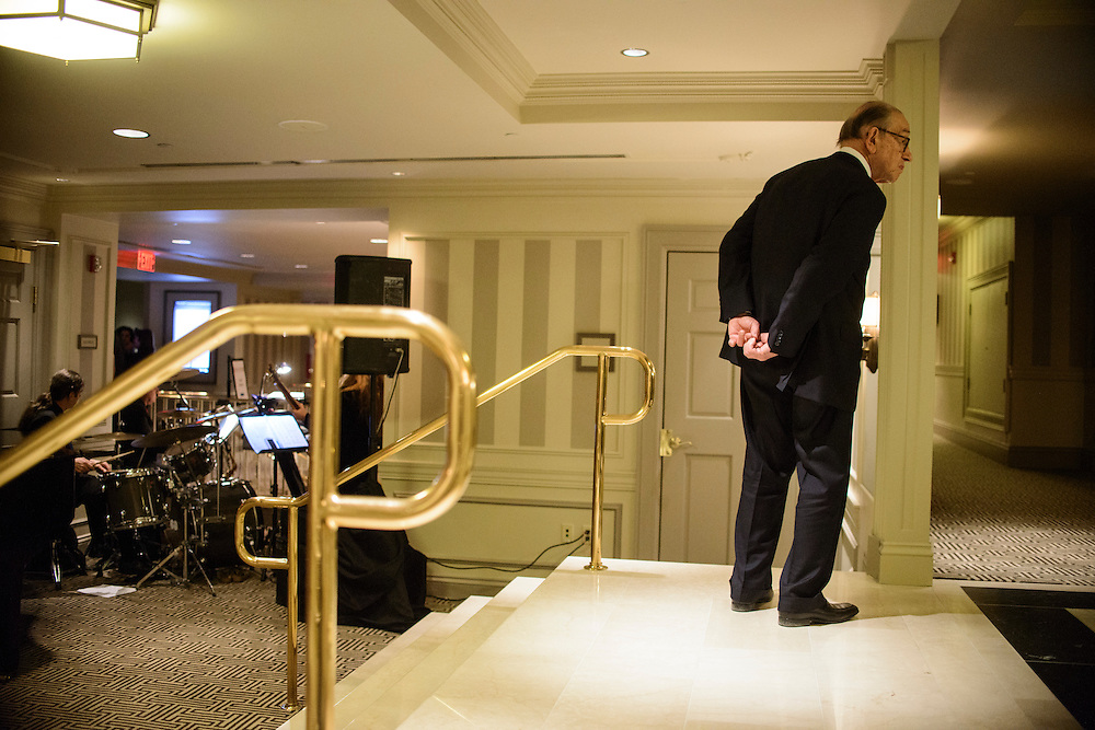 "Photo by Matt Roth.Assignment ID: 10137379A..Former Treasury Secretary Alan Greenspan waits for his wife Andrea Mitchell, a television news anchor during Buffy and Bill Cafritz, Ann and Vernon Jordan, Vicki and Roger Sant's inaugural ""Bi-Partisan Celebration"" at the Dolley Madison Ballroom at the Madison Hotel in Washington, D.C. on Sunday, January 20, 2013."