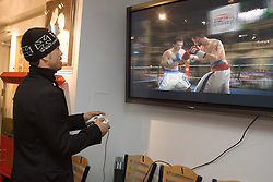 Welterweight contender Arturo Gatti checks out the new Electronic Arts Fight Night Round 3 video game.  Gatti is the cover star along with Mickey Ward.  The two fighters engaged in three terrific fights, with Gatti winning two.  The game will officially release on February 14, 2006 on the Xbox, Xbox 360, PSP and PS2 platforms.