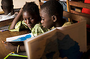 Children attend a geography class at the Kabiline I Primary school in the village of Kabiline, Senegal on Wednesday June 13, 2007...