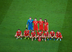 CARDIFF, WALES - Friday, September 6, 2019: Wales players line-up for a team group photograph before the UEFA Euro 2020 Qualifying Group E match between Wales and Azerbaijan at the Cardiff City Stadium. Back row L-R: goalkeeper Wayne Hennessey, Chris Mepham, Joe Rodon, Ethan Ampadu. Front row L-R: Daniel James, Neil Jones, Joe Allen, captain Gareth Bale, Connor Roberts, Tom Lawrence, Harry Wilson. (Pic by Paul Greenwood/Propaganda)