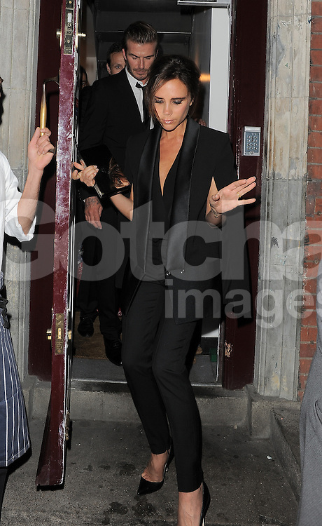 David Beckham and Victoria Beckham attend LFW s/s 2014: AnOther Magazine party at LouLou's in Mayfair, London, UK. 16/09/2013<br />