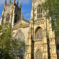 Brief History of York Minster in York, England<br /> Several churches stood on this site before York Minster. The earliest were finished in 627, 637, the late 8th century and 1080. Building of the current cathedral began in 1220 under the orders of the Archbishop of York, Walter de Gray. In 1472 – over 250 years later – it was considered finished.  Throughout its history, it was plundered during the English Reformation, threatened by civil war, suffered from fires in 1829, 1840 and 1984 and been endangered of collapse.  On each occasion, the treasured landmark was restored. Measuring 524 feet long and 222 feet wide, it is Northern Europe's second biggest Gothic Cathedral. This matches the Archbishop of York's second highest rank in the Church of England.