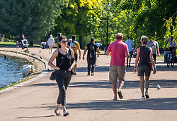 © Licensed to London News Pictures. 19/05/2020. London, UK. Members of the public in the sunshine in Hyde Park as weather experts predict a high of 27c this week. Last week the Government eased the law on lockdown to let people spend more time outside. Photo credit: Alex Lentati/LNP