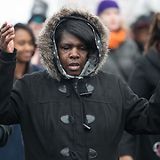 Tammy Curtis of St. Paul is moved to tears while participating in the #ReclaimMLK march organized by Black Lives Matter Minneapolis in conjunction with Ferguson Action's national day of action on the Rev. Martin Luther King, Jr. national holiday in St. Paul, Minnesota on January 19, 2015.  <br /> <br /> The event also was attended by the family of Marcus Golden, who was killed by St. Paul police officers last week. <br /> <br /> Photo by Angela Jimenez for MPR<br /> photographer contact 917-586-0916