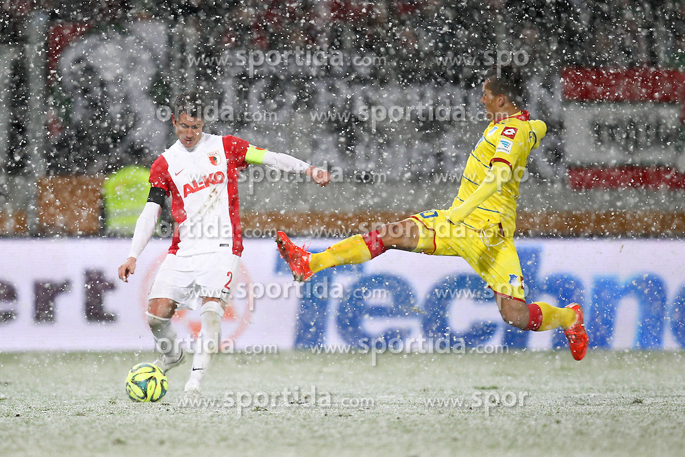01.02.2015, SGL Arena, Augsburg, GER, 1. FBL, FC Augsburg vs TSG 1899 Hoffenheim, 18. Runde, im Bild l-r: im Zweikampf, Aktion, mit Paul Verhaegh #2 (FC Augsburg) und Roberto Firmino #10 (TSG 1899 Hoffenheim) // during the German Bundesliga 18th round match between FC Augsburg and TSG 1899 Hoffenheim at the SGL Arena in Augsburg, Germany on 2015/02/01. EXPA Pictures &copy; 2015, PhotoCredit: EXPA/ Eibner-Pressefoto/ Kolbert<br /> <br /> *****ATTENTION - OUT of GER*****