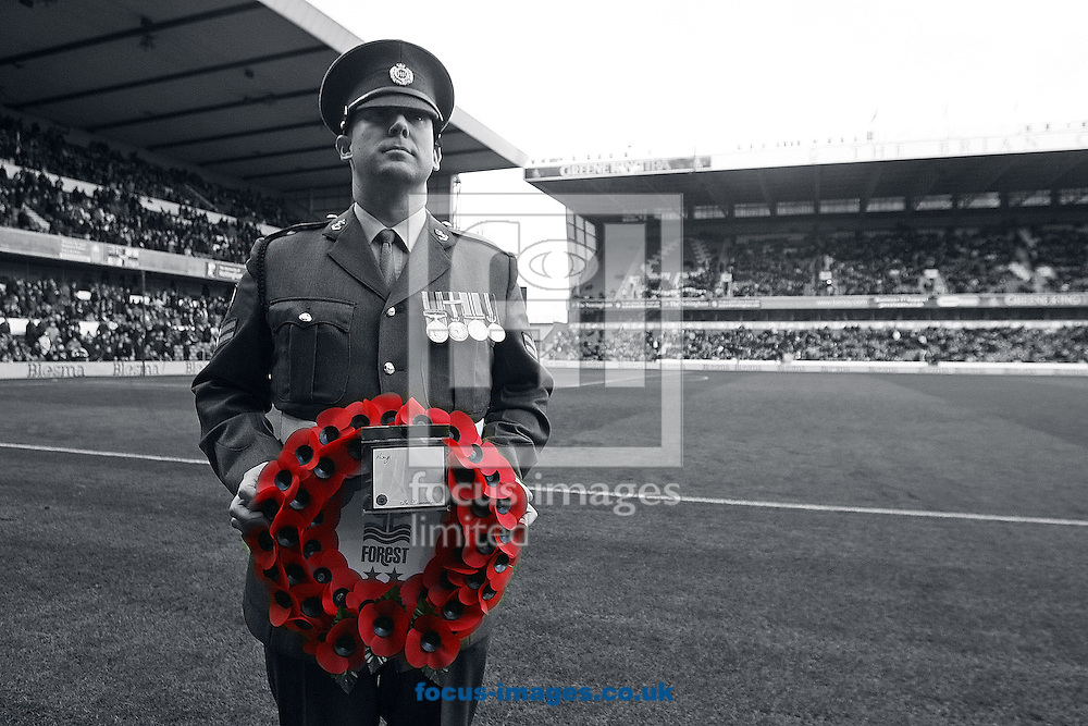A serviceman proudly holds a wreath before the Sky Bet Championship match at the City Ground, Nottingham<br /> Picture by Paul Chesterton/Focus Images Ltd +44 7904 640267<br /> 08/11/2014