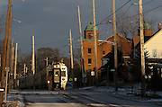 A westbound South Shore Line train travels Saturday through downtown Michigan City.