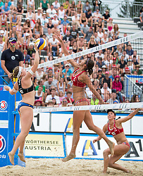 30.07.2014, Strandbad, Klagenfurt, AUT, FIVT, A1 Beachvolleyball Grand Slam 2014, Hauptrunde, im Bild Katharina Schützenhofer (AUT) gegen Ekaterina Syrtseva (RUS), Alexandra Shiryaeva Moiseeva (RUS) // during Main Draw Match of the A1 Beachvolleyball Grand Slam at the Strandbad Klagenfurt, Austria on 2014/07/30. EXPA Pictures © 2014, EXPA Pictures © 2014, PhotoCredit: EXPA/ Johann Groder