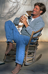 Jack Russell Puppy licking a man's face