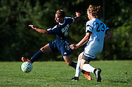 Burlington's Jack Miller (5) kicks the ball past Rice's Hayden Kjelleran (23) during the boys soccer game between the The Burlington Seahorses and the Rice Green Knights at Rice Memorial high School on Tuesday afternoon September 15, 2015 in South Burlington, Vermont. (BRIAN JENKINS/for the FREE PRESS)