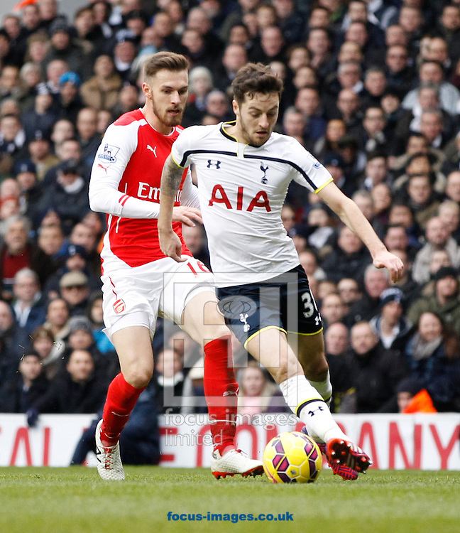 Ryan Mason of Tottenham Hotspur (R) goes past Aaron Ramsey of Arsenal (L) during the Barclays Premier League match at White Hart Lane, London<br /> Picture by Andrew Tobin/Focus Images Ltd +44 7710 761829<br /> 07/02/2015