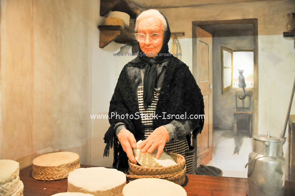 women in kitchen A display of traditional country life at Bodega El Paratge wine shop and museum located near Tossa de Mar and Lloret de Mar, Costa Brava, Catalonia, Spain
