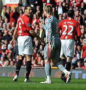 Rio Ferdinand shouts at Liverpool Fernando Torres during the Barclays Premier League match between Manchester United and Liverpool at Old Trafford on March 14, 2009 in Manchester, England.
