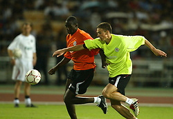 BANGKOK, THAILAND - Wednesday, July 23, 2003: Liverpool's Anthony Le Tallec (r) and Djimi Traore during a training session in at the Rajamangala National Stadium. (Pic by David Rawcliffe/Propaganda)