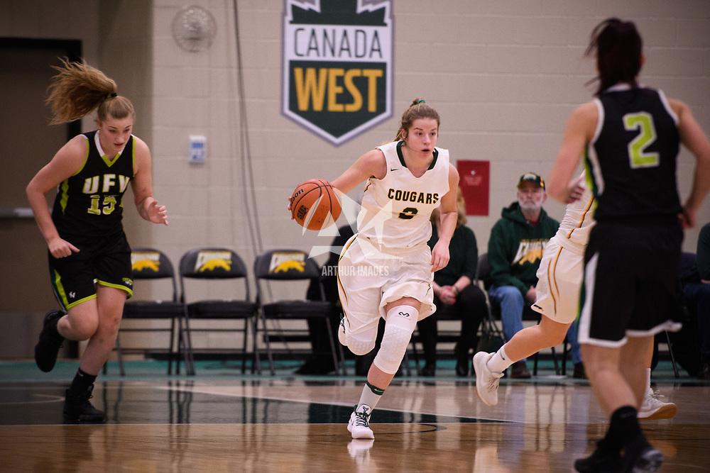 3rd year guard Michaela Kleisinger (2) of the Regina Cougars in action during the home opener on November  10 at Centre for Kinesiology, Health and Sport. Credit: Arthur Ward/Arthur Images