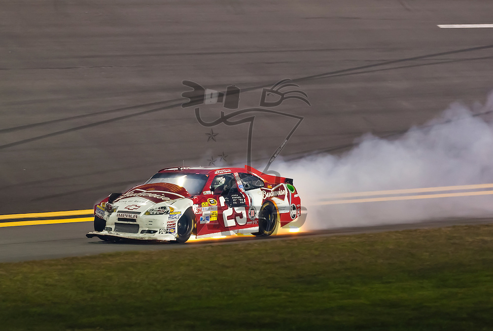 Daytona Beach, FL - Feb 18, 2012:  Kevin Harvick (29) brings his Budweiser Chevrolet through turn 4 after crashing during the Budweiser Shootout at the Daytona International Speedway in Daytona Beach, FL.