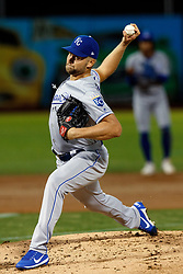 OAKLAND, CA - SEPTEMBER 16: Glenn Sparkman #57 of the Kansas City Royals pitches against the Oakland Athletics during the first inning at the RingCentral Coliseum on September 16, 2019 in Oakland, California. The Kansas City Royals defeated the Oakland Athletics 6-5. (Photo by Jason O. Watson/Getty Images) *** Local Caption *** Glenn Sparkman