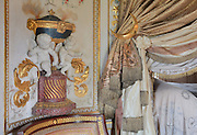 """Detail of putti which opened hands were designed to hold small torchs, curtain tie backs crescent moon shapped, Turkish Boudoir, redesigned in 1777 for Marie Antoinette, by architect Richard Mique, Chateau de Fontainebleau, France. The decoration is the achievement of the brothers Rousseau, and the furniture dates to the period of the First Empire, with precious textile work done by Jacob-Desmalter for Empress Josephine. Including a small bedroom, mirrors, and curtains raised by pulleys, this exceptional ensemble has been restored in 2014 thanks to the support of INSEAD and the generosity of subscribers of sponsors belonging to the group """"Des Mécènes pour Fontainebleau"""". Its opening to the public is schedule for Spring 2015. Picture by Manuel Cohen"""